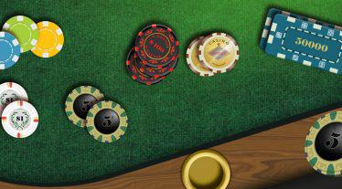 Poker-Table-with-a-lot-of-different-style-casino-chips