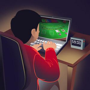 Guy playing online blackjack with a timer next to him