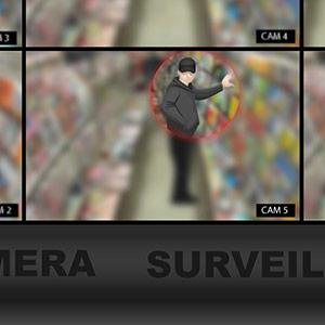 An illustration of a surveillance camera screen spotting a man with a cap attempting shoplifting.