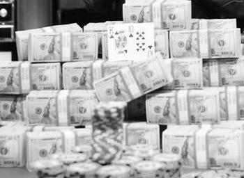 a big stack of dollar piles and chips in black and white