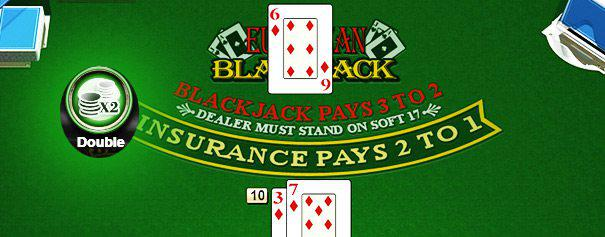 blackjack table with a pair of players cards against one dealer card