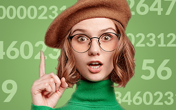 young female in glasses and hat pointing upward