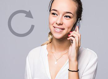 happy looking woman holding mobile to ear