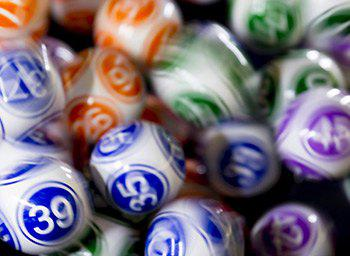 Keno numbers depicted on a pile of bingo balls