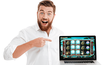 happy male in a shirt pointing to laptop