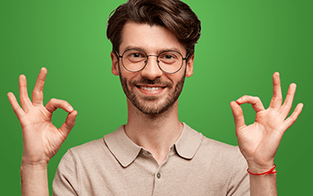 male in glasses holding up both hands