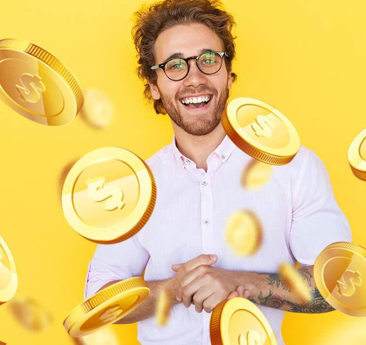 online baccarat winner smiling, holding his hands while coins flying around