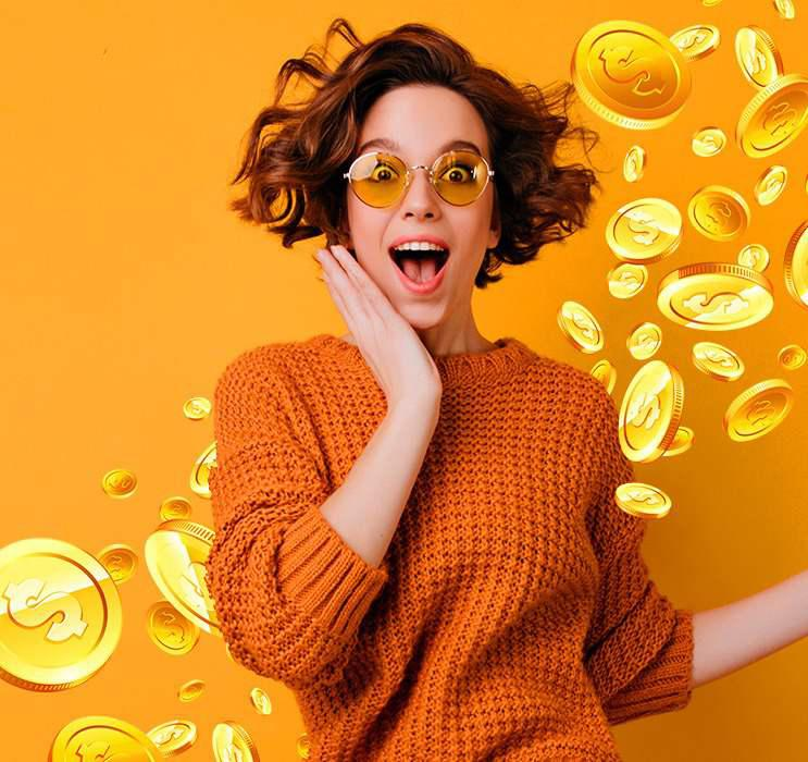 Happy female Keno player holding face in awe with gold coins falling in orange background