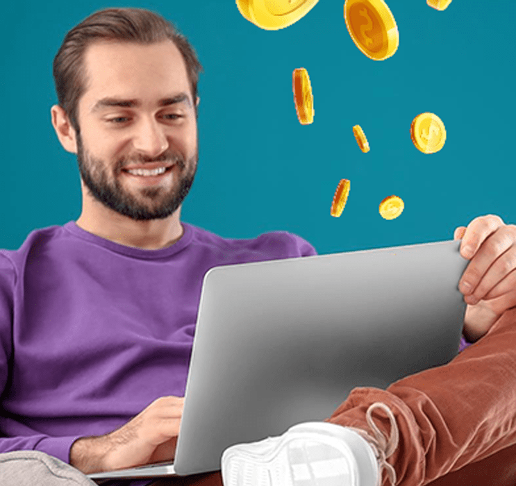 Male Sat On Laptop Playing Real Money Casino