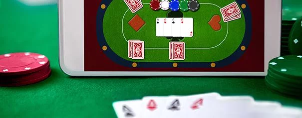 video poker on mobile screen lying on a poker table