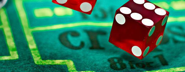 Close-up of dice falls on a craps table