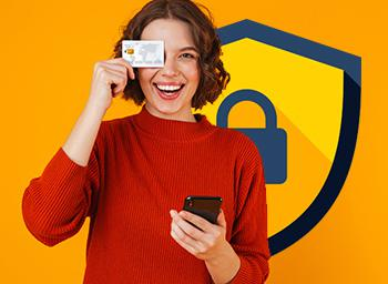 Female holding mobile phone and covering eye with piece of card