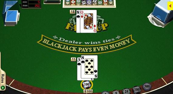 Blackjack table with a dealer and player cards