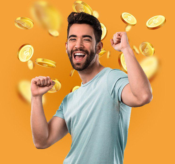 Young bearded male cheering with gold coins falling in background