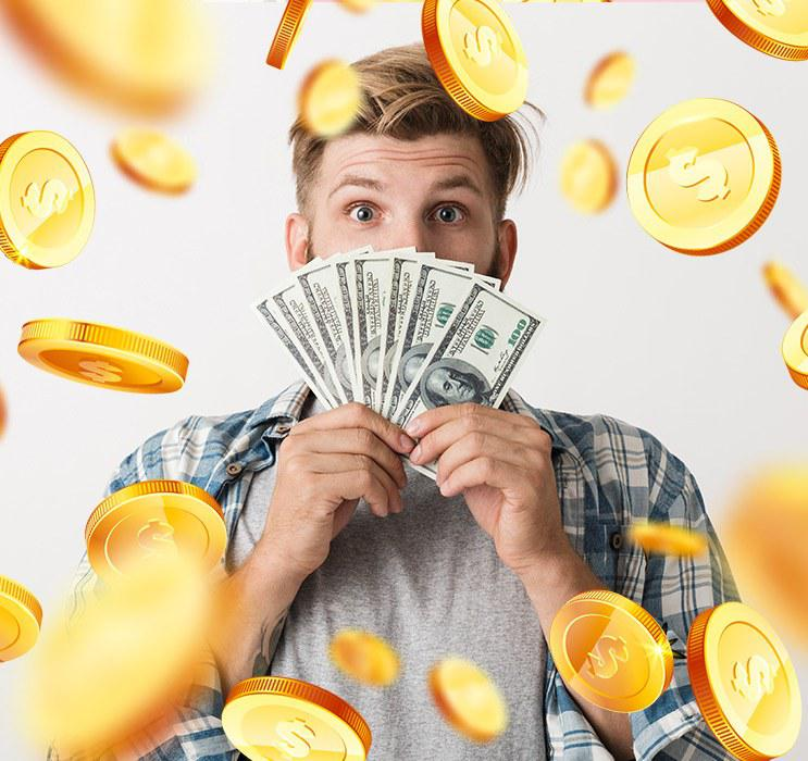 Male in chequered shirt holding fan of money with gold coins in background