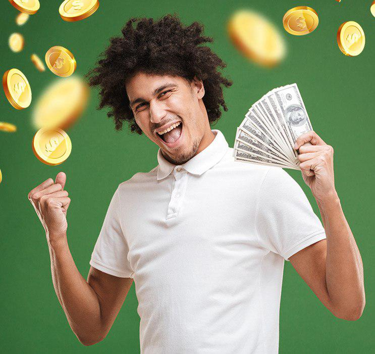 Male Keno player cheering and holding money with gold coins falling in green background