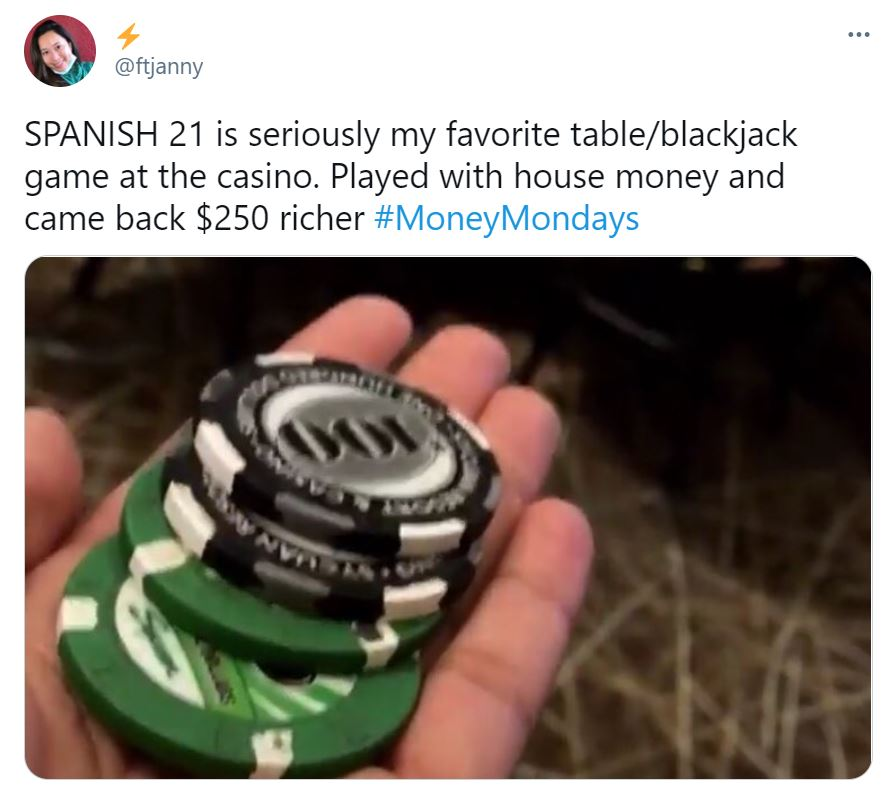 Hand Holding Poker Chips After Winning Spanish 21 Game